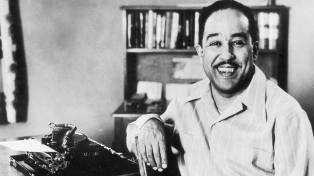 American poet, novelist, and playwirght, Langston Hughes at work on his typewriter