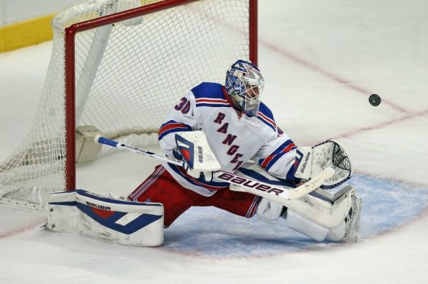 New York Rangers goalie Henrik Lundqvist doing his usual defensive acrobatics