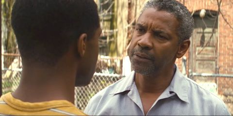 Actor Denzel Washington talking with his son in the movie, Fences.