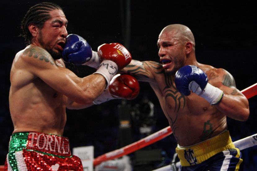 Photo: Antonio Margarito taking a punch from Miguel Cotto