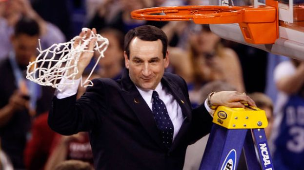 Duke University's Men's Head Basketball Coach Mike Krzyzewski obtaining a basketball net after securing 1,000 wins as a college head basketball coach