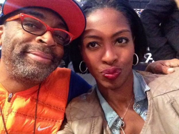 Legendary Filmmaker Spike Lee and What's The 411TV and What's The 411Sports reporter Crystal Lynn at Barclays Center for Brooklyn Nets v New York Knicks game.