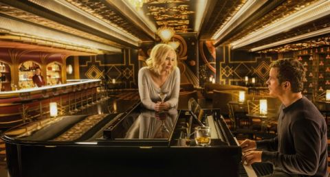 Actor Chris Pratt serenading Jennifer Lawrence by playing piano at a bar on the Starship Avalon in the movie Passengers