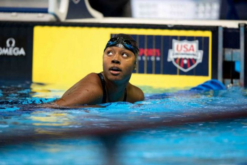 Simone Manuel of Sugar Land, Texas, wins first place and gold medal for the 100m individual swimming contest at the 2016 Summer Olympic games in Rio de Janeiro