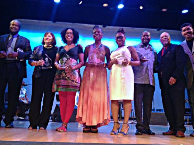 The 2015 Phillis Wheatley Book Award winners with awrd-winning novelist Omar Tyree (far right)
