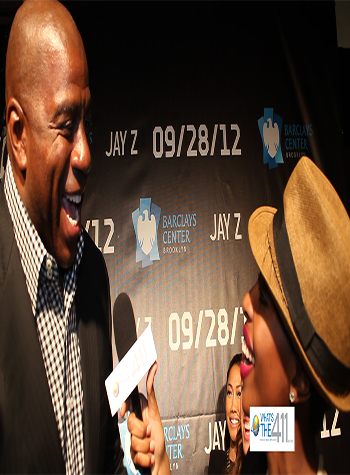 Magic-Johnson-and-What's The 411 reporter Crystal Lynn at Barclays Center Opening