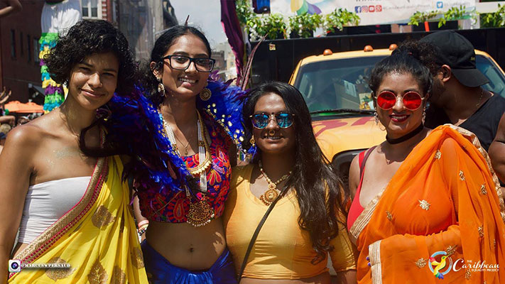 4 Indian women prideful masqueraders photo credit Marcus W Persaud 711x400