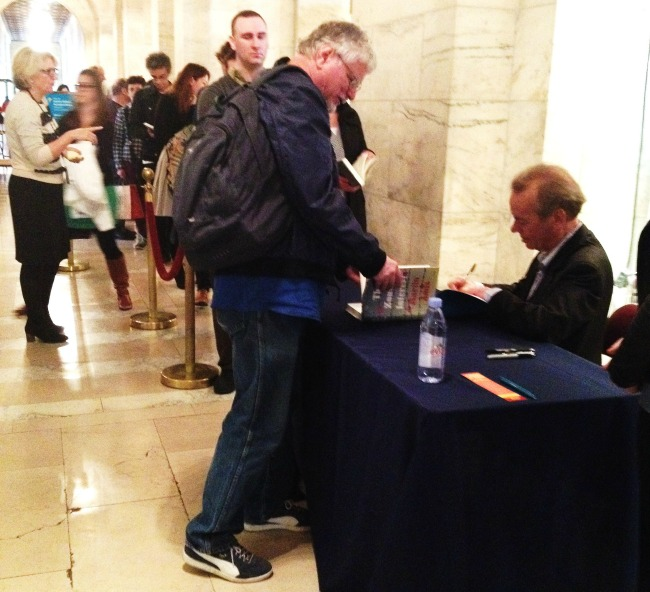 Author-Martin-Amis-signing-book-The-Zone-of-Interest 650x592