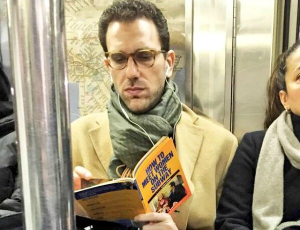 Man-reading HOW-TO-MEET-WOMEN-ON-THE-SUBWAY by-Brian-Robinson 639x490