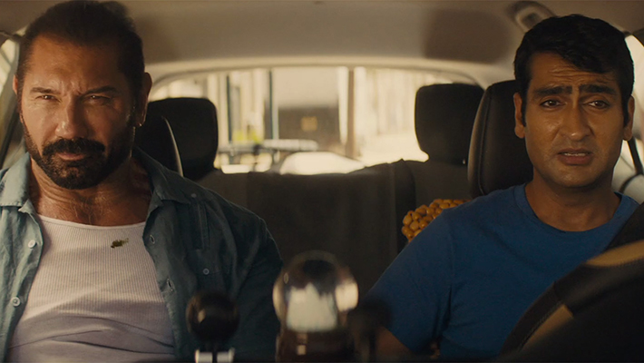 Stuber the movie lead characters Dave Bautista and Kumail Nanjiani in Uber vehicle photo courtesy of Walt Disney 710x400