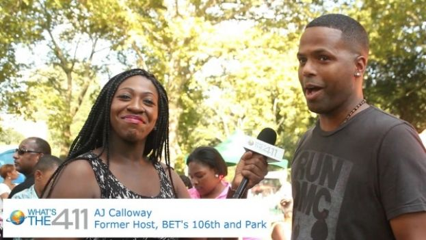 AJ Calloway, former host of BET's 106th and Park, talking with What's The 411 reporter, Cristina Twitty at the Celebration of 40 Years of Hip-Hop in Central Park in New York City