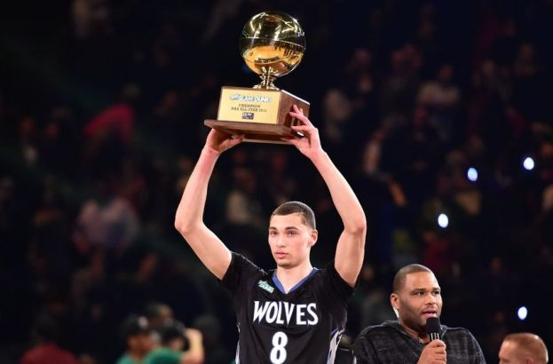 Minnesota Timberwolves Zach LaVine hoisting the Sprite Slam Dunk Contest trophy