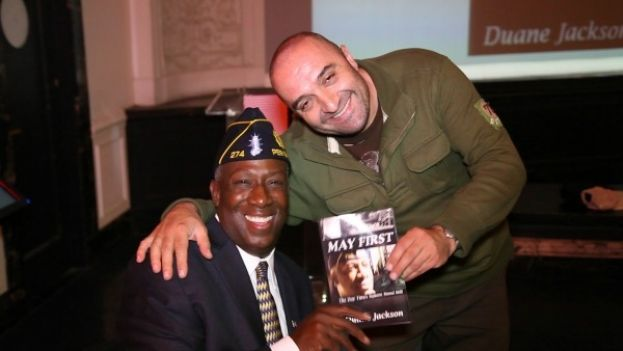 Duane Jackson (left) at his book signing party for his new book, MAY FIRST