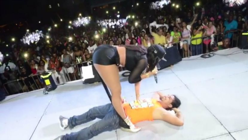 Destra standing over Fernando Oliva, a man at one of her concerts who suffered injuries from one of her dance moves.