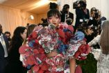Rihanna on the red carpet at the 2017 Met Gala in a Comme de Garcons look