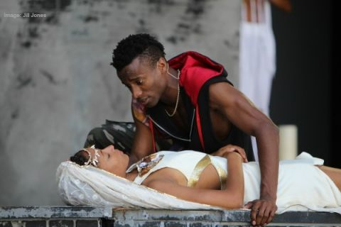 Romeo encounters Juliet on her death bed in the Classical Theatre of Harlem's rendition of Romeo and Juliet