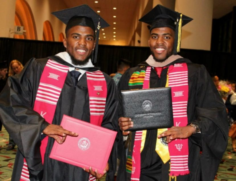 Freddie Perry and his twin brother graduating with Master's Degrees