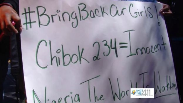 Protesters holding a sign at the rally to Bring Back Our Girls, the nearly 300 Nigerian schoolgirls kidnapped by Boko Hiram