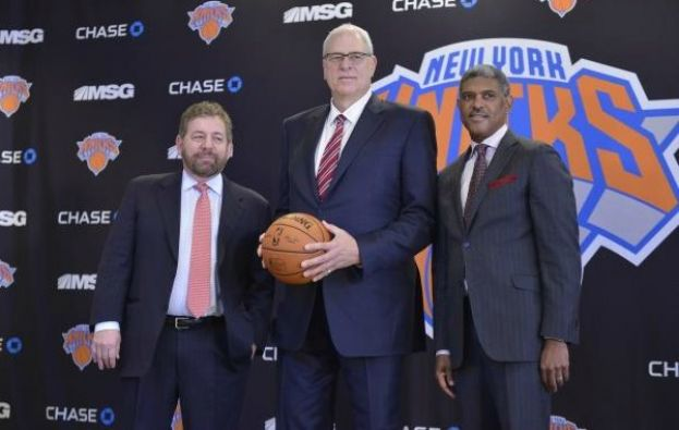 James Dolan, Chairman, Madison Square Garden (l) and Knicks General Manager Steve Mills (r) introduce Phil Jackson as President of the New York Knicks to media at a press conference at Madison Square Garden