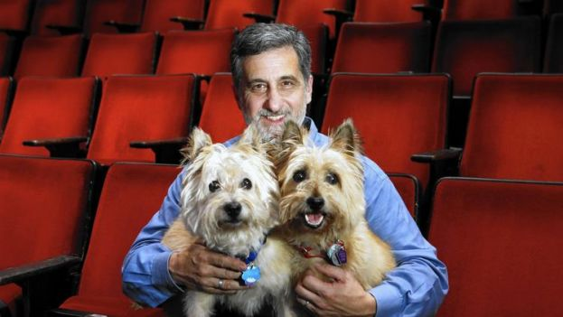 Two dogs that play the role of Toto in The Wiz Live! with their trainer, Bill Berloni
