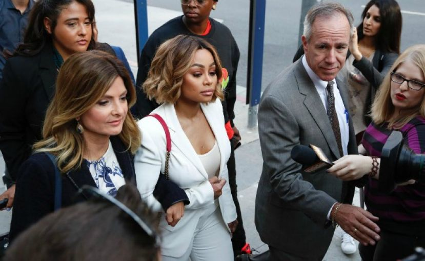 Blac Chyna (center) on her way into court accompanied by her attorney Lisa Bloom (on left) with the hopes of receiving a temporary restraining order against Rob Kardashian, the father of her daughter, Dream Kardashian.