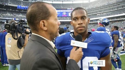 What's The 411Sports reporter Andrew Rosario talking with New York Giants wide receiver Victor Cruz after a game.