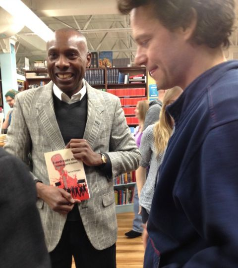 Carl Unegbu, author of Comedy Under Attack, talking with audience members at Book Culture