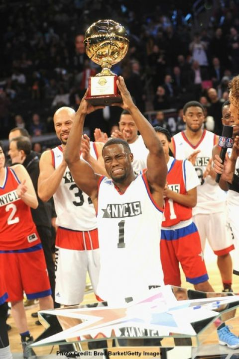 Comedian Kevin Hart holding his fourth NBA All-Star Celebrity Game MVP Award