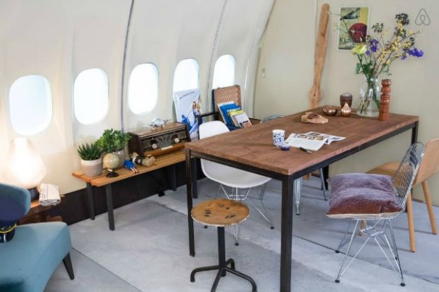 Office/Dining Area inside converted KLM airplane listed on Airbnb