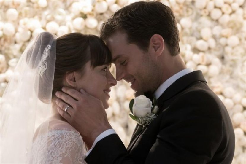 Dakota Johnson (left) and Jamie Dornan in marriage scene in Fifty Shades Freed