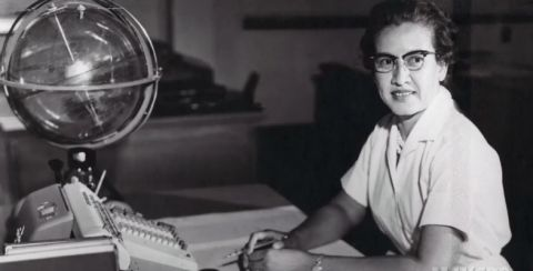 Katherine Johnson, an African-American physicist, and mathematician, at her desk at NASA