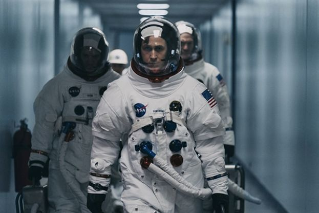 Ryan Gosling (center) stars as Neil Armstrong, the first man to step foot on the moon